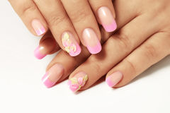 Pink nail polish on the nails of women. Pink nail polish on nails of women Stock Photos