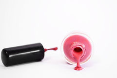 Pink Nail Polish. Spilling out of the bottle Royalty Free Stock Photos