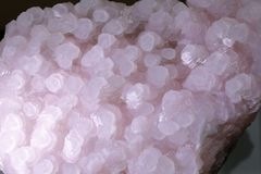 Pink natural crystal ore crystalline, adobe rgb. Translucent pretty pink natural crystal ore royalty free stock image