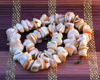Pink necklace of sea shells Royalty Free Stock Photo