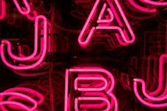 Pink Neon Letters (1). Bright Pink Neon Letters Sign Royalty Free Stock Photography
