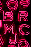Pink Neon Letters (3). Bright Pink Neon Letters Sign Stock Photos