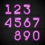 Pink neon light alphabet numbers Stock Photos
