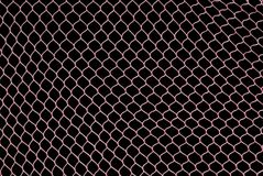 Pink Netting. Stretched against black background Royalty Free Stock Photos