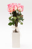 Pink nicole rose. In white vase Stock Image