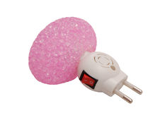 Pink night lamp with electrical plug and switch Stock Photo