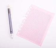 Pink notebook. And grey pen royalty free stock image