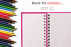 Pink notebook and color pencils Royalty Free Stock Photo