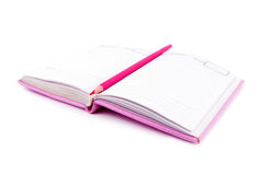 Pink notebook and pencil Stock Photo
