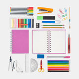Pink notebook and school or office tools on white background. To back to school Royalty Free Stock Photos