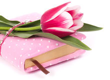 Pink notebook and tulips Royalty Free Stock Images
