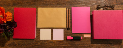 Pink notebooks on desk Stock Images
