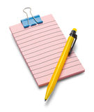 Pink Notepad and Pencil. Small Lined Pink Notepad and Yellow Pencil Isolated on a White Background Royalty Free Stock Photo