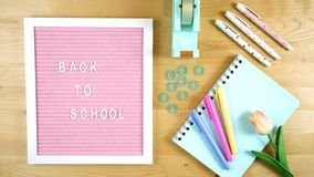 Pink notice board with Back to School message . Pink notice board with Back to School message flatlay royalty free stock photo