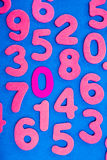 Pink Numbers on Blue Background Stock Photo