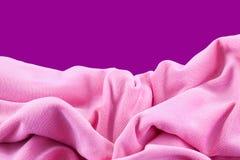 Pink nylon. A pink nylon fabric on purple background Stock Photos