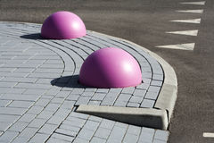 Pink obstacles on the pavement Stock Image