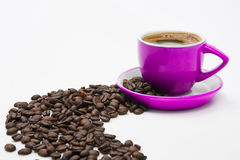 Pink offee cup and beans Stock Image
