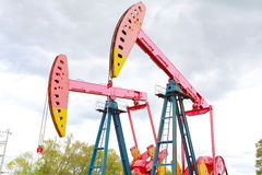 Pink Oil pump of crude oilwell rig Stock Images