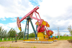 Pink Oil pump of crude oilwell rig Royalty Free Stock Image