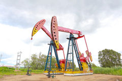 Pink Oil pump of crude oilwell rig Stock Photos