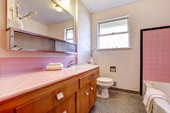 PInk old bathroom interior with tub. Stock Photo