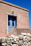 Pink old house with blue shutters and door on the island Susak Royalty Free Stock Images