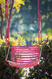 Pink old  and rusty iron swings Royalty Free Stock Images
