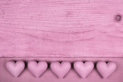Pink old wooden background with five hearts for a greeting card. Stock Photography