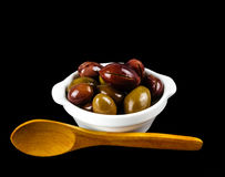 Pink olives in a white bowl on black. Stock Photos