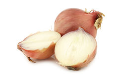 Pink onion and a cut one Royalty Free Stock Photography