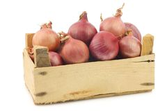 Pink onions in a wooden crate Stock Photo