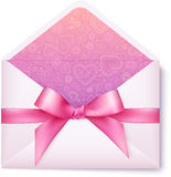 Pink open envelope with pink bow Royalty Free Stock Photography