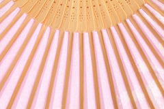Pink opened fan as a background. Stock Image