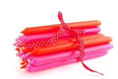 Pink and orange candles Royalty Free Stock Photo