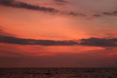 Pink and Orange Color Tropical Sunset Sky over the Gentle Wave Sea. Thailand Royalty Free Stock Images