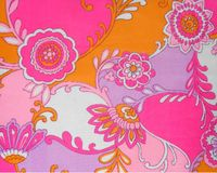 A sample of the fabric: the pink-orange colours with floral motifs Royalty Free Stock Photo