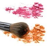 Pink and orange crushed powder and blush isolated on white background. Pink and orange crushed powder and blush isolated on white background Stock Photos