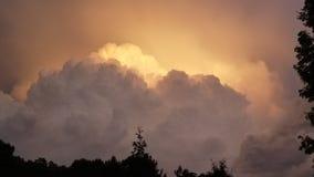 Pink & Orange Lightning. Orange pink lightning storm clouds stock photo