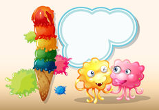 A pink and an orange monster beside the giant icecream Stock Photos