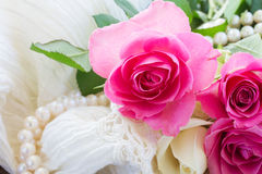 Pink and orange roses with lace Royalty Free Stock Photography