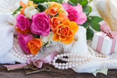Pink and orange roses with lace Royalty Free Stock Photo