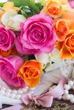 Pink and orange roses with lace Stock Photos