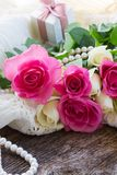 Pink and orange roses with lace Stock Photo