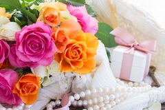 Pink and orange roses with lace Stock Photography