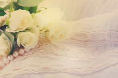 Pink and orange roses with lace Stock Image