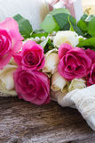 Pink and orange roses with lace Royalty Free Stock Photos