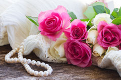Pink and orange roses with lace Stock Images
