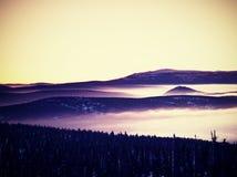 Pink orange sun rise above misty winter mountains Royalty Free Stock Photo