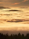 Pink orange sun rise above misty winter mountains Stock Image